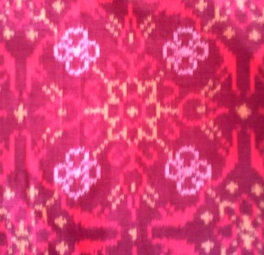 warp ikat: vertical threads were dyed before weaving so design is slightly blurred where adjacent threads do not match exactly