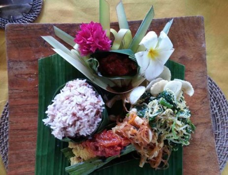 Balinese dish served on banana leaf. Note red rice, a native variety.