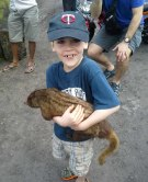 Eric holds a rather disinterested mongoose