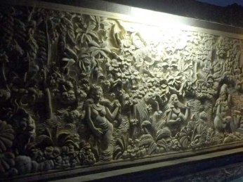 Carved stone mural above swimming pool at our apartment, Taman Agung