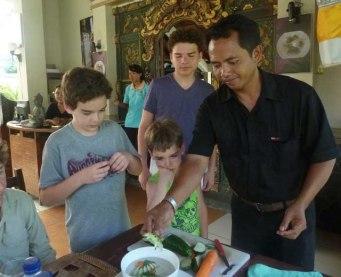 Chef demonstrates preparing decorative vegetables.