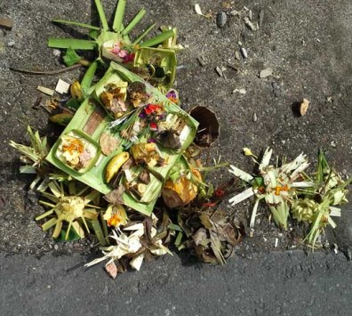 Elaborate offerings on pavement at an intersection