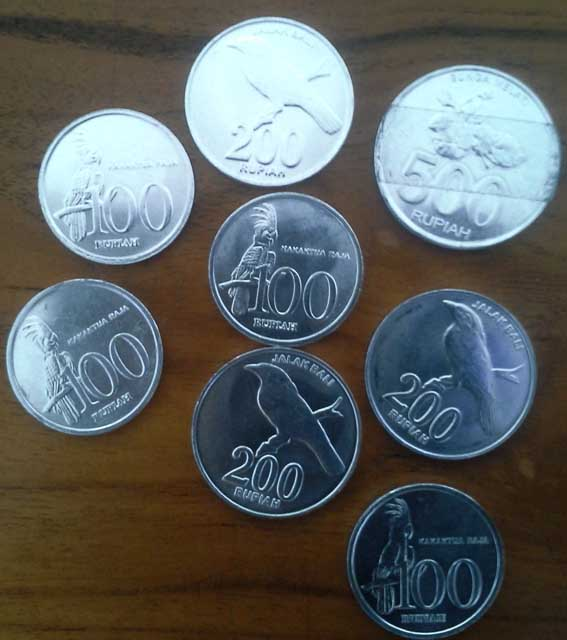 If one dollar equals 13,000 rupiah, what is the value of these coins in dollars?